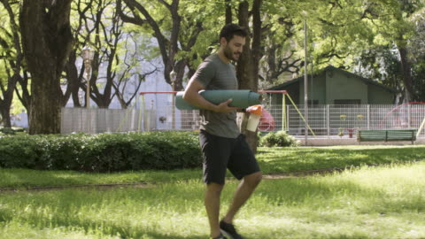 a young man preparing training in a city park - public park stock videos & royalty-free footage
