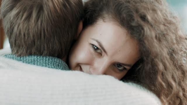 young man proposing young woman at home - fidanzato video stock e b–roll