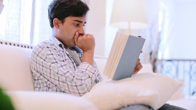 young man reading a book - aspirations stock videos & royalty-free footage
