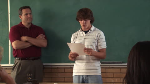 young man reading a paper in class - see other clips from this shoot 1148 stock videos & royalty-free footage