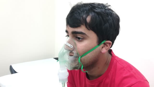 young man receiving asthma care at a medical clinic - inhaling stock videos & royalty-free footage