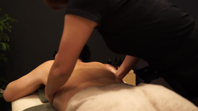 Young man receiving oil massage