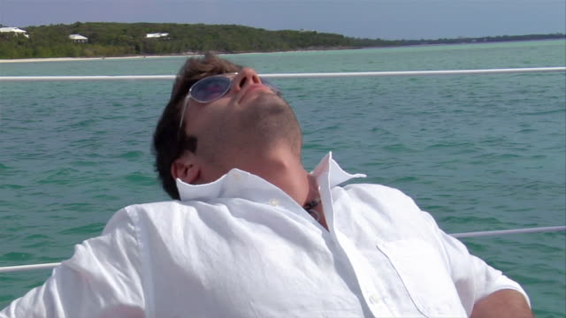 CU, Young man relaxing on boat, portrait, Harbour Island, Bahamas