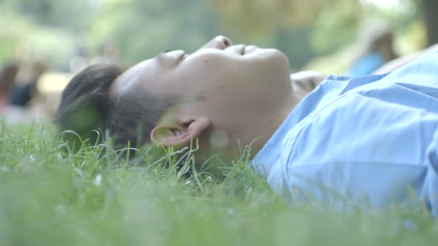 Young man relaxing on grass