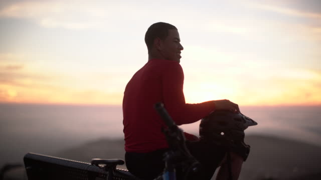 ms young man resting after mountain biking - single cloud sky stock videos & royalty-free footage