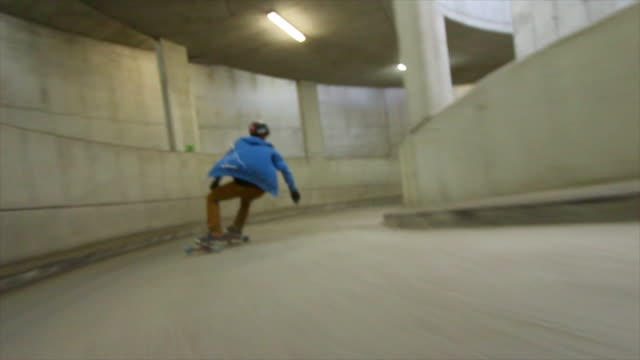 a young man rides his skateboard down a parking ramp. - time-lapse - gefahr stock-videos und b-roll-filmmaterial