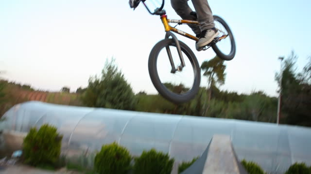 a young man riding a bmx bicycle. - 1920x1080 - bmx cycling stock videos and b-roll footage