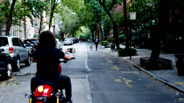 young man riding a motorcycle in new york city - motorcycle racing stock videos and b-roll footage