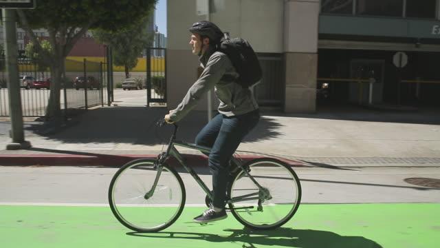 Young man riding bike