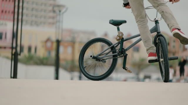 young man riding bmx. - freestyle bmx stock videos and b-roll footage