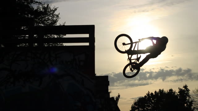 A young man riding his BMX bicycle.