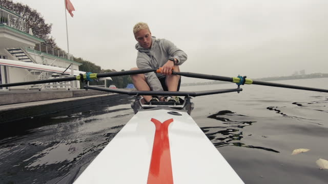 young man rowing boat in river - one man only stock videos & royalty-free footage