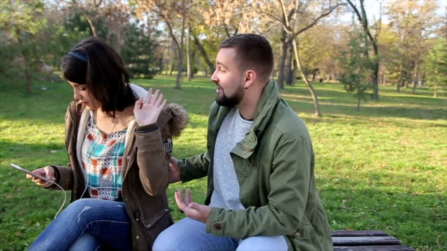 young man rude flirting with girl in the park - flirting stock videos & royalty-free footage
