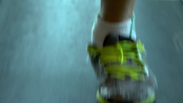 young man running and walking on treadmill close up shot - racewalking stock videos and b-roll footage