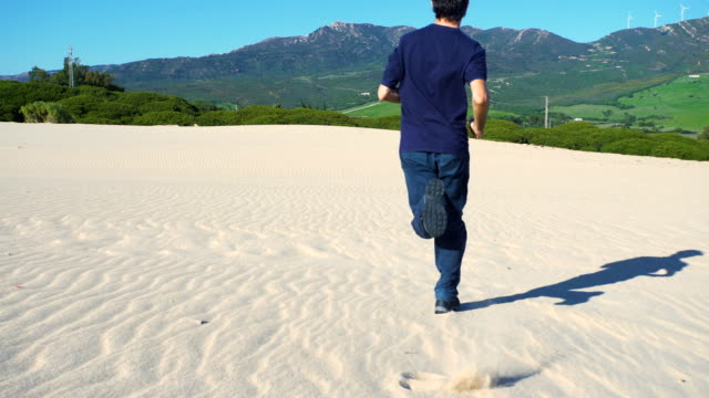 a young man running in a dune sand - one mid adult man only stock videos & royalty-free footage
