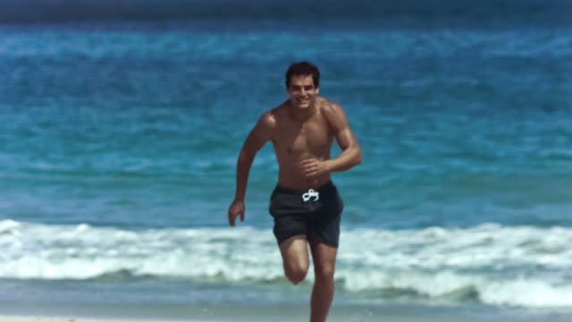 young man running in slow motion in shorts - running shorts stock videos & royalty-free footage