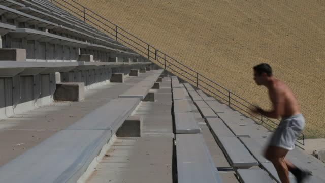 WS Young man running up stadium steps / Santa Fe, New Mexico, USA