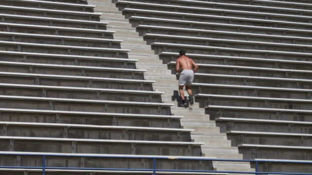 WS Young man running up stadium steps / Santa Fe, New Mexico, USA