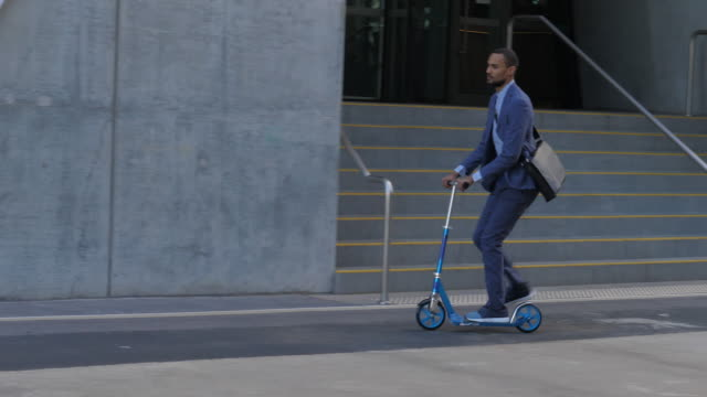 young man rushing on scooter