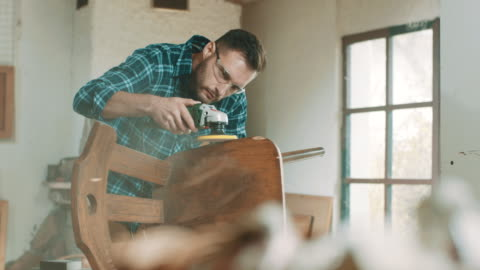 young man sanding a chair - one young man only stock videos & royalty-free footage