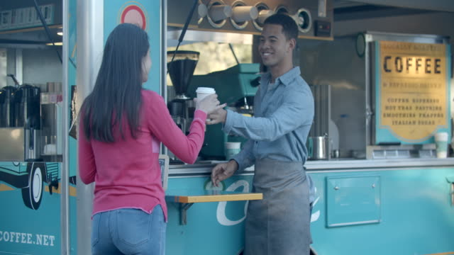 young man serving a customer from a food truck - selling stock videos & royalty-free footage