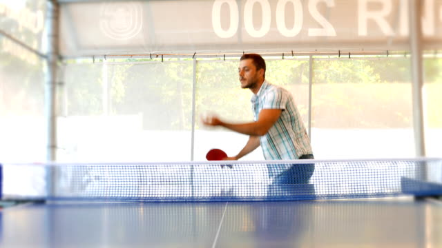 young man serving table tennis ball towards the camera - table tennis bat stock videos & royalty-free footage