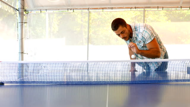 young man serving the ball in a table tennis game - table tennis bat stock videos & royalty-free footage