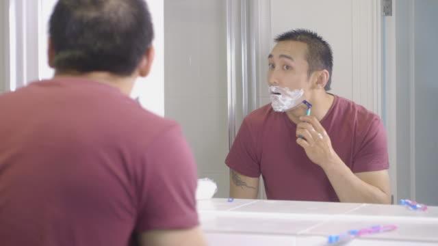 young man shaving - razor stock videos & royalty-free footage