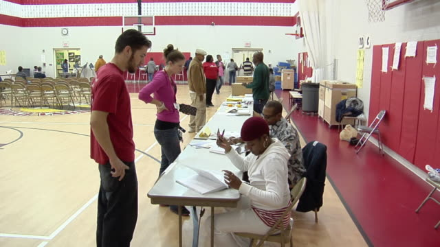 MS, ZI, ZO, Young man signing in at registration table at polling place, Toledo, Ohio, USA