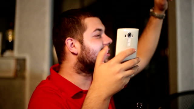 a young man singing on the phone - electronic organizer stock videos and b-roll footage