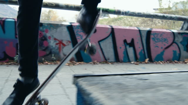 ms young man skateboarding at urban skate park - skateboard stock videos and b-roll footage