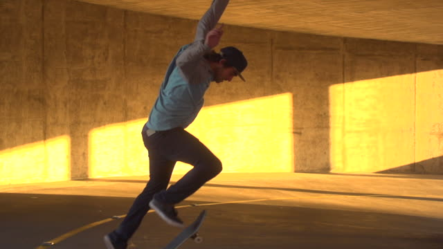 A young man skateboarding in a parking garage. - Slow Motion - filmed at 240 fps