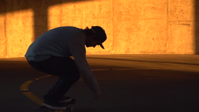 A young man skateboarding in a parking garage. - Slow Motion - filmed at 240 fps