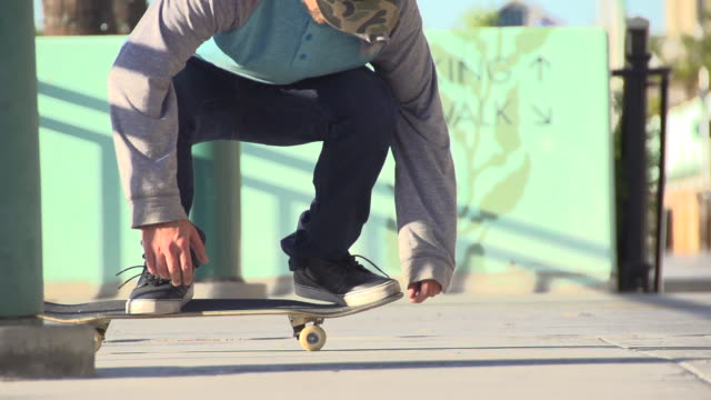 a young man skateboarding. - slow motion - filmed at 240 fps - stunt stock videos & royalty-free footage