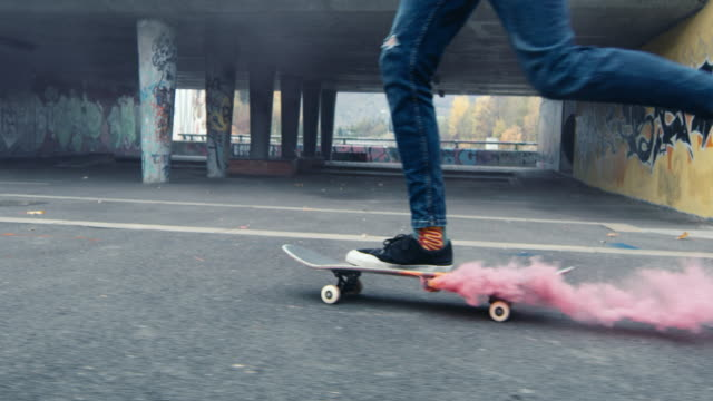 ms young man skateboarding with smoke bomb on ramp at urban skate park - sports ramp stock videos and b-roll footage