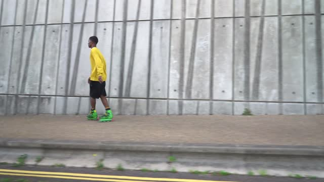 a young man skating down an empty street - one teenage boy only stock videos & royalty-free footage