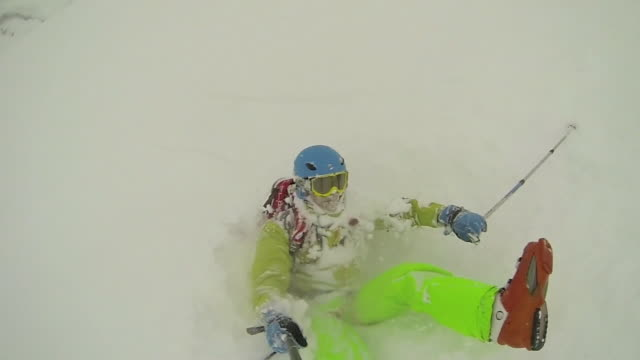 young man skier skiing down mountain in japan. - slow motion - winter sport stock videos and b-roll footage