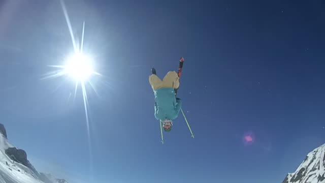 A young man skiing doing a backflip off of a jump.  - Slow Motion - filmed in Ischgl, Tirol, Austria, Europe