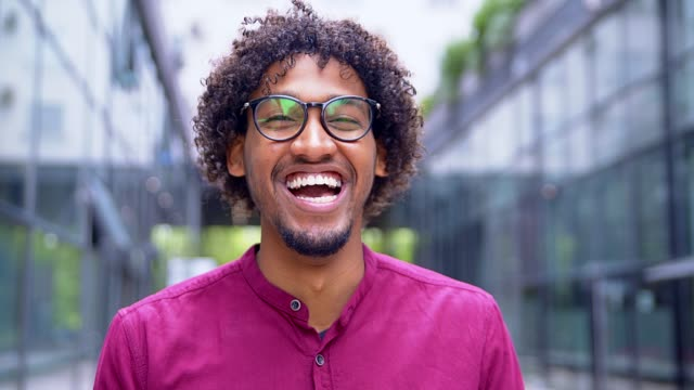 young man smiling - sorridere video stock e b–roll