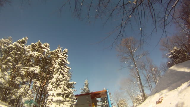 a young man snowboarding through trees and jumping over a playhouse. - slow motion - model released - hd - spielzeughaus stock-videos und b-roll-filmmaterial