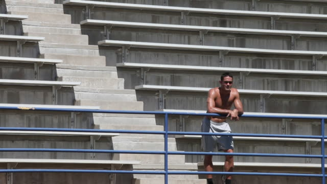 ms young man standing in stadium / santa fe, new mexico, usa - tribuna video stock e b–roll