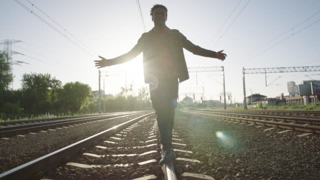 young man standing on the railroad truck. rock and roll style. - music video stock videos and b-roll footage