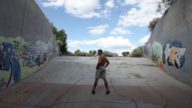 ws young man standing outside tunnel with hand on hip / santa fe, new mexico, usa  - hand on hip stock videos and b-roll footage