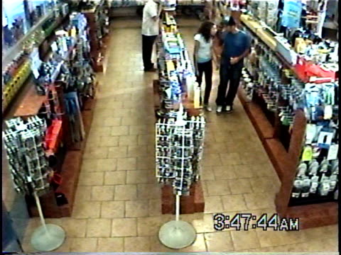ha ws young man stealing soda bottle in convenience store while another man stands nearby, then leaves with his girlfriend / brooklyn, new york, usa - dieb stock-videos und b-roll-filmmaterial