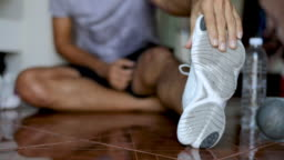 young man stretches the body before exercise