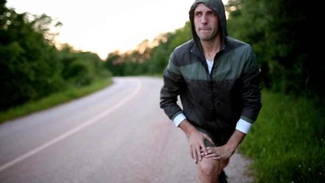 young man stretching his leg before a run - warm up exercise stock videos & royalty-free footage
