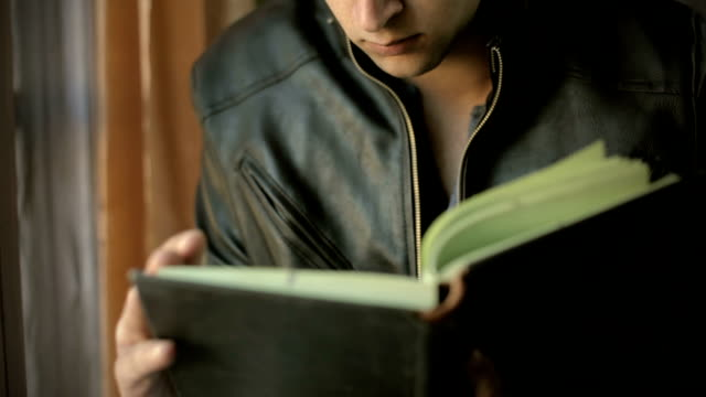 young man studying a book at home and thinking. - exam stock videos & royalty-free footage
