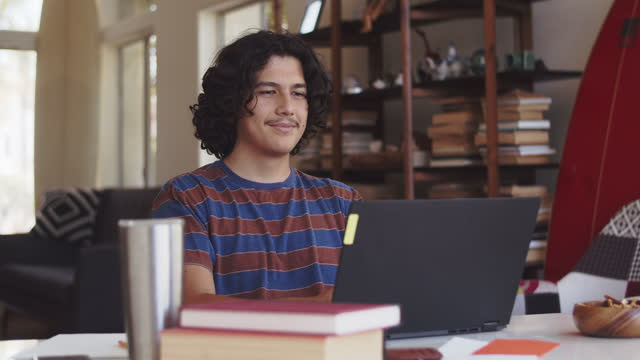 young man studying at home - hot desking stock videos & royalty-free footage