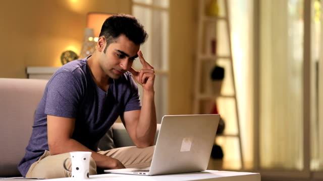 young man suffering from headache, delhi, india - malattia video stock e b–roll