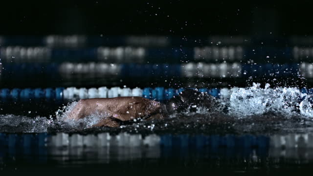 Young Man Swimming Front Crawl